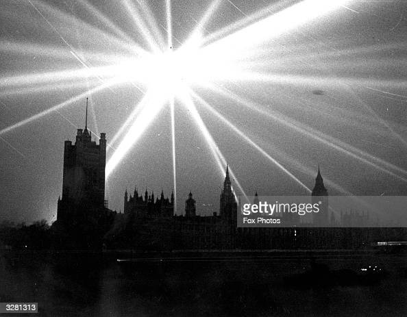 A searchlight over the Houses of Parliament London