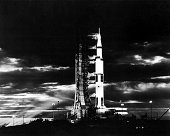 Searchlights illuminate this nighttime view of Apollo 17 spacecraft on its launchpad.