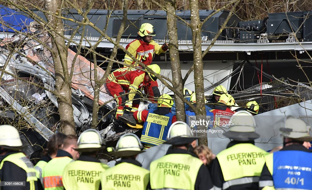 Searchrescue team workers and firefighters are seen on duty at the two trains' collision site after two commuter trains collied on a route close to...