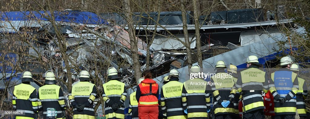 Search-rescue team workers and firefighters are seen on duty at the two trains' collision site after two commuter trains collied on a route, close to Bad Aibling, approximately 60 kilometers (40 miles) southeast of Munich, Germany on February 09, 2016. At least 8 killed and several others injured after the collision, reported.