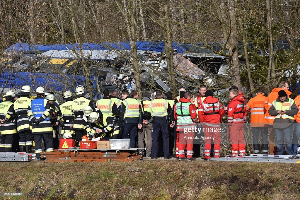 Search-rescue team workers and firefighters are seen on duty on a two trains' collision site after two commuter trains collied on a route, close to Bad Aibling, approximately 60 kilometers (40 miles) southeast of Munich, Germany on February 09, 2016. At least 8 killed and several others injured after the collision, reported.