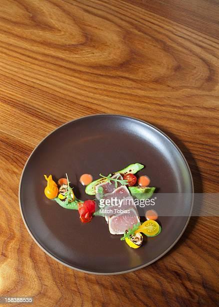 Seared ahi tuna on plate.