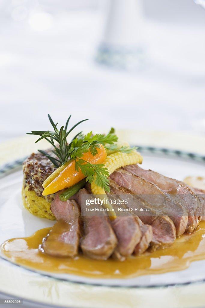 Seared alpaca with quinoa : Stock Photo