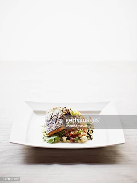 Seared coho salmon served over farro salad