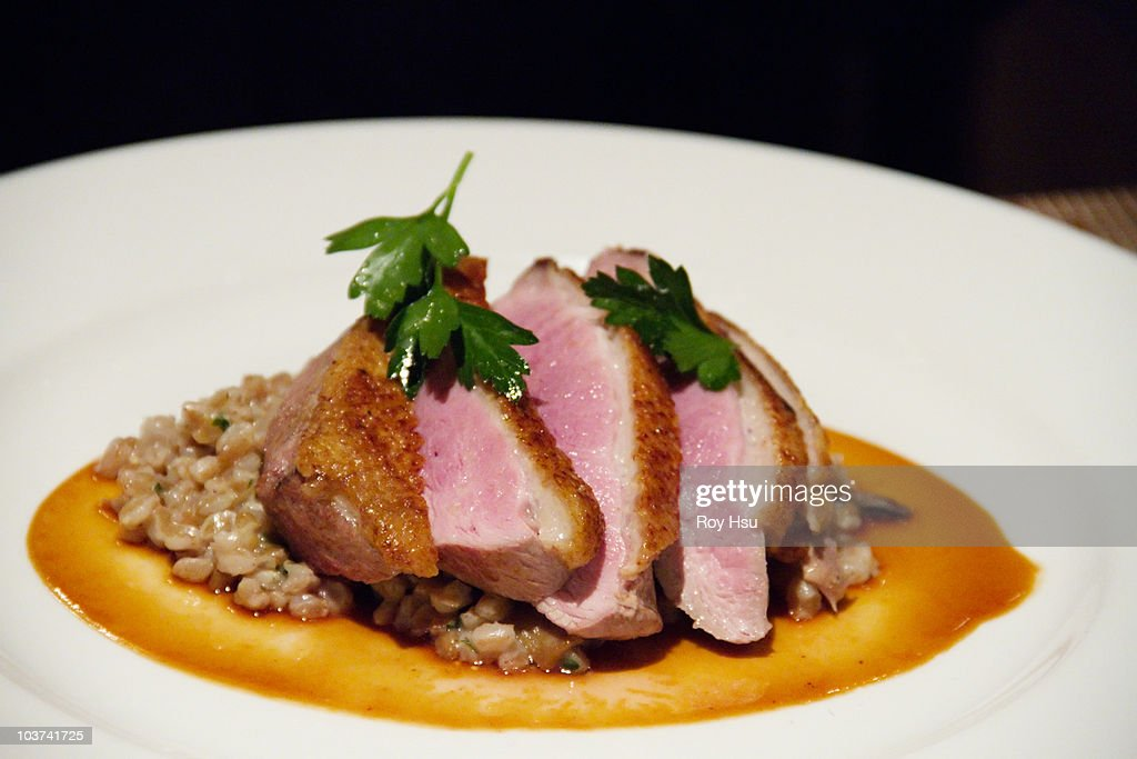 Seared duck breast over lentils : Stock Photo