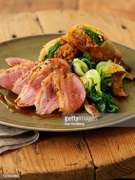Seared duck breasts with braised duck spring rolls
