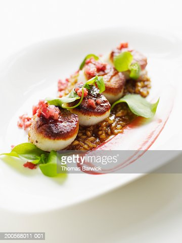 Seared rare scallops with sweet onion risotto and rhubarb : Stock Photo