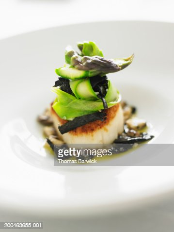 Seared scallop with asparagus, black trumpet mushrooms and tapenade