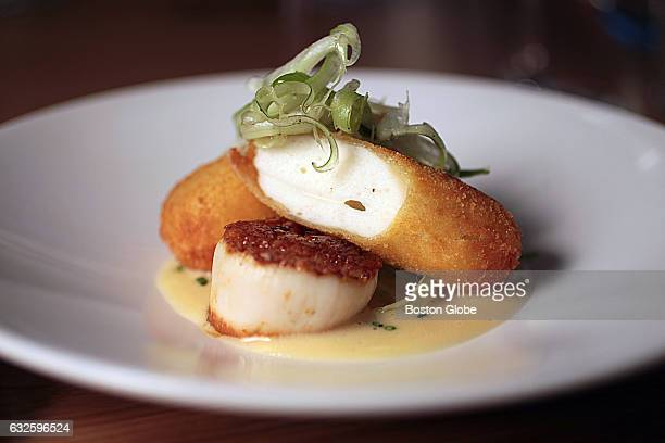 Seared scallop with scallop boudin fennel chives and ginger is pictured at Parsnip restaurant in Cambridge MA on Feb 2 2016