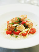 Seared scallops with herb salad, tomatoes, fennel and cous cous