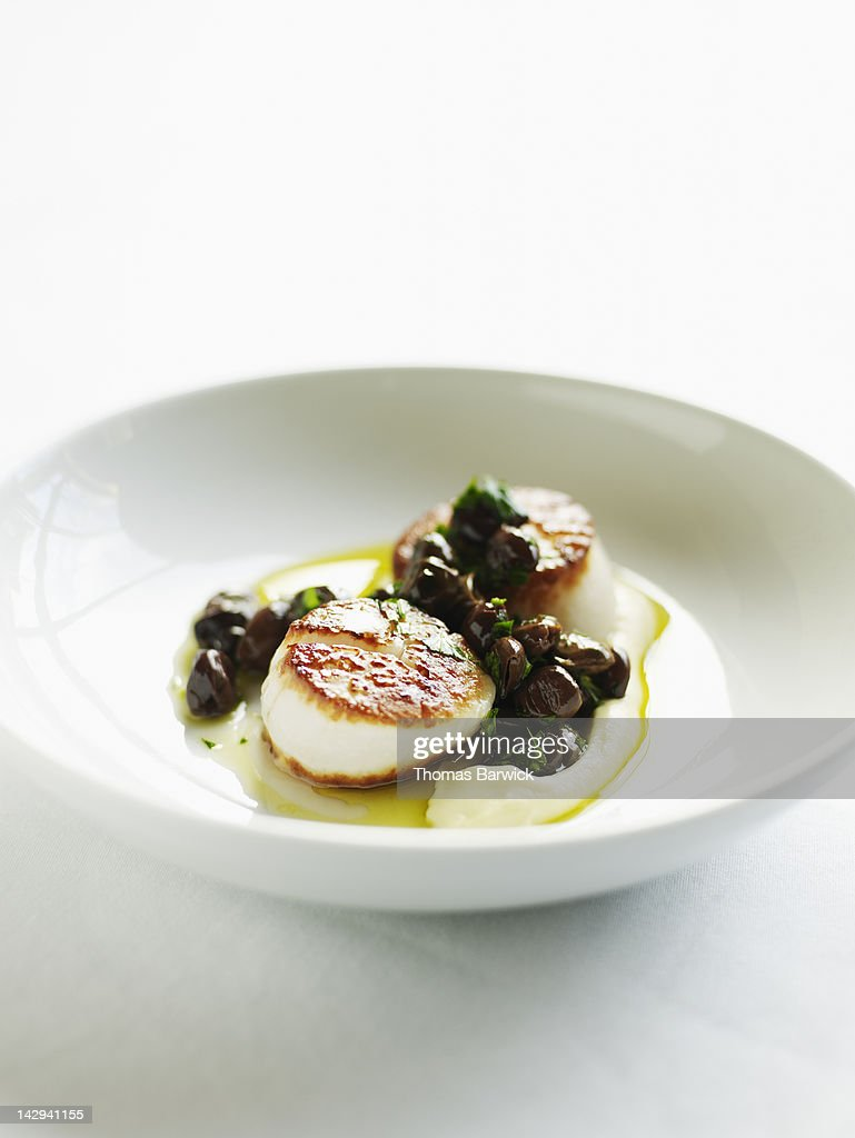 Seared sea scallops with artichoke puree : Stock Photo