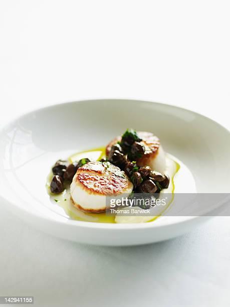 Seared sea scallops with artichoke puree