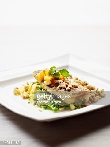 Seared skate fish served over salad : Stock Photo