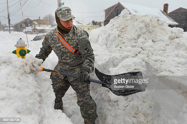 Seargent Miguel Familia from Methuen with the 181st Engineering Company shovels out a hydrant on Nantasket Ave Ocean effect snow and wind battered...