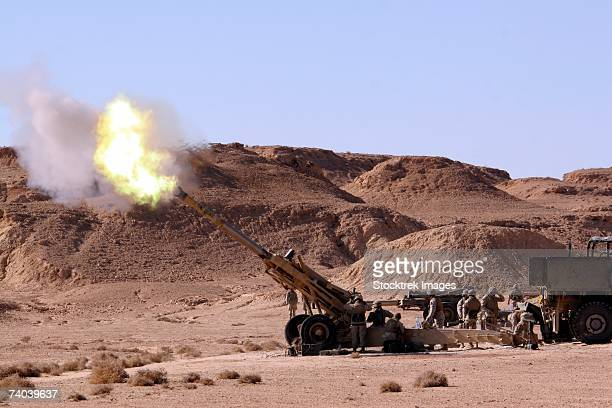 Searing flame and smoke emerge from the muzzle of an M198 Howitzer belonging to Battery C, 1st Battalion, 11th Marine Regiment, during an artillery shoot conducted in the Al Anbar Province of Iraq November 23.