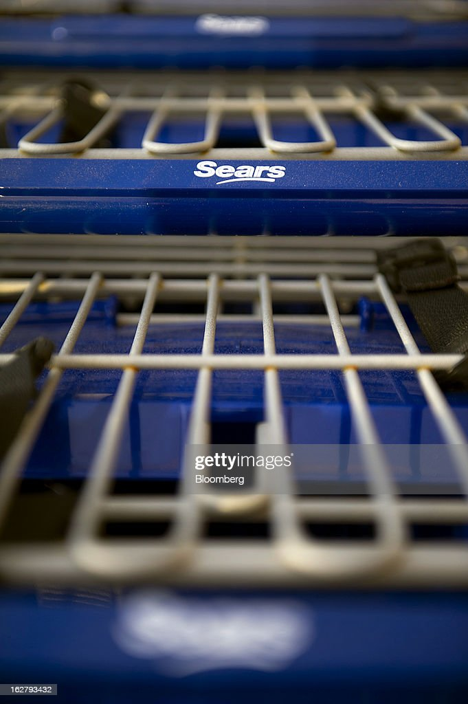 Sears Holdings Corp. signage is displayed on shopping carts at a Sears Holdings Corp. store in Richmond, California, U.S., on Tuesday, Feb. 26, 2013. Sears Holdings Corp. is expected to release earnings data on Feb 28. Photographer: David Paul Morris/Bloomberg via Getty Images