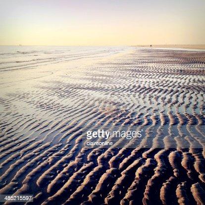 Seascape and sand on beach : Stock Photo