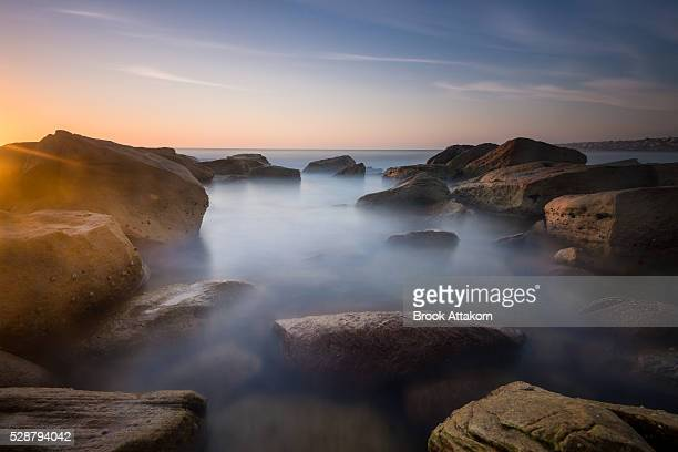 seascape sunset with rocks.