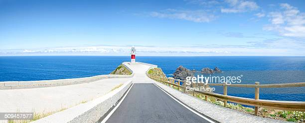Seascape with blue sky. Lighthouse on the coast