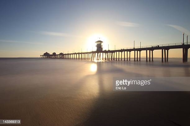 Seascape with pier at sunset