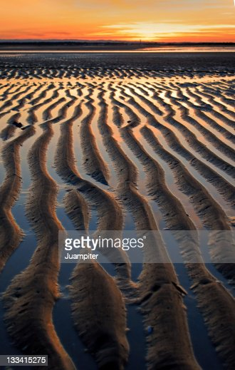 Seashore ripples sunset