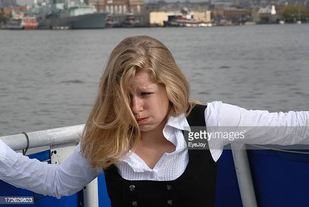 Seasick Young Woman in Boat