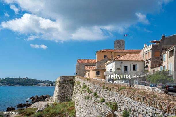 Seaside of Antibes  old port , Cathedral and Picasso Museum in Grimaldi  alace among  old buildings, Alpes Maritimes, France