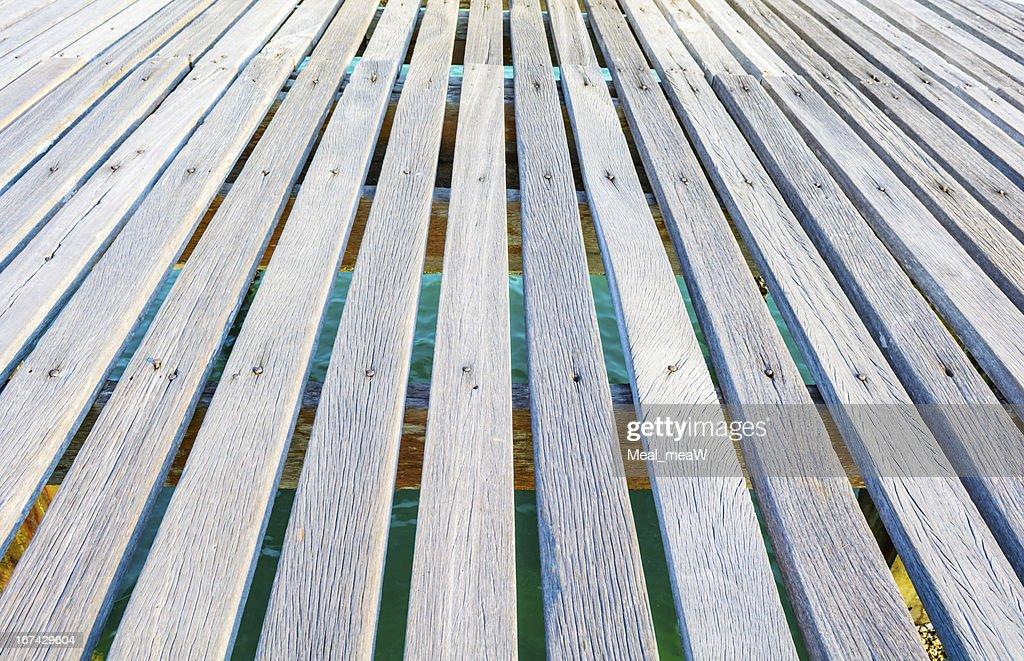 Seaside wooden bridge with sea background : Stock Photo