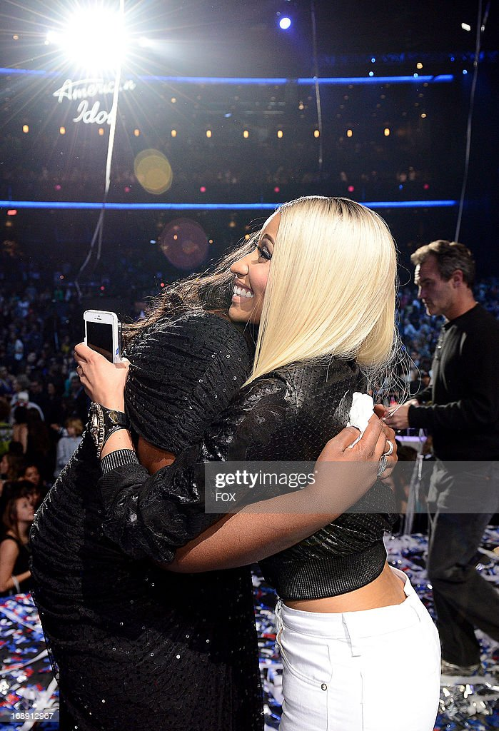 Season 12 winner Candice Glover (L) and judge <a gi-track='captionPersonalityLinkClicked' href=/galleries/search?phrase=Nicki+Minaj+-+Artiste+de+spectacle&family=editorial&specificpeople=6362705 ng-click='$event.stopPropagation()'>Nicki Minaj</a> onstage at FOX's 'American Idol' Season 12 Live Finale Show at Nokia Theatre L.A. Live on May 16, 2013 in Los Angeles, California.