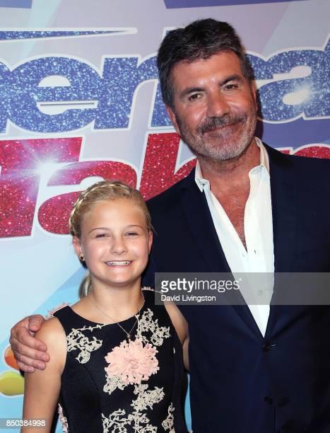 Season 12 winner ventriloquist Darci Lynne Farmer and judge/executive producer Simon Cowell attend NBC's 'America's Got Talent' season 12 finale at...