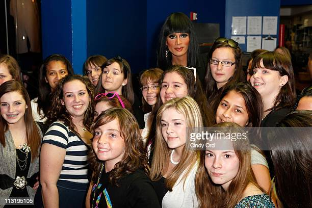 Season 3 winner of RuPauls Drag Race Raja poses with fans at Planet Hollywood Times Square on April 26 2011 in New York City