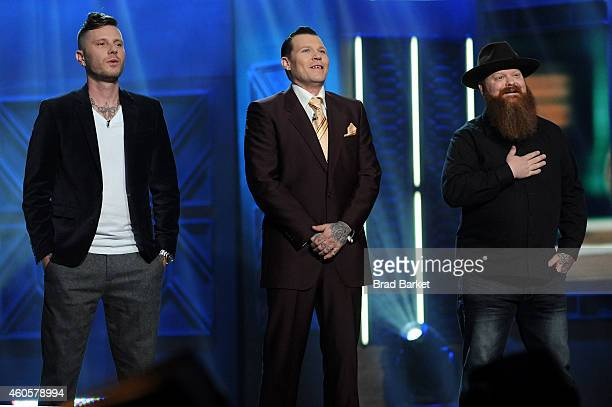 Season 5 finalists Erik Siuda Cleen Rock One and Jason Clay Dunn react onstage at 'Ink Master' Season Five Live Finale at Manhattan Center Grand...