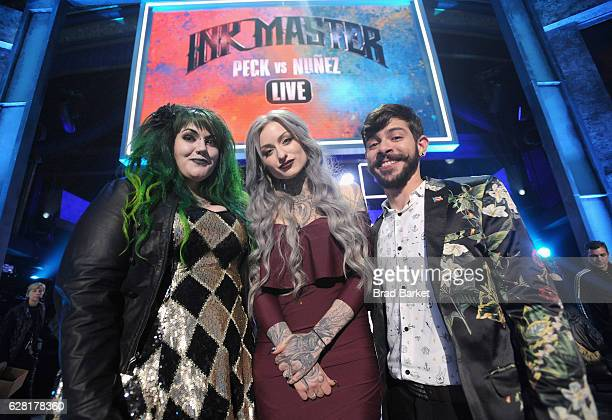 Season 8 finalists Kelly Doty and Gian Karle pose with season 8 winner of 'Ink Master' Ryan Ashley onstage during 'Ink Master' Season 8 Live Finale...