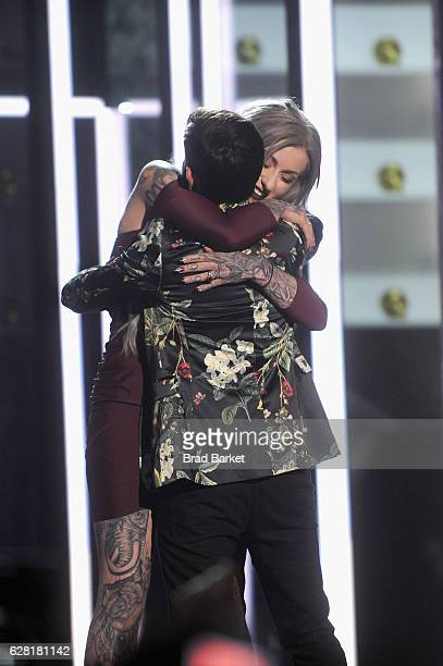 Season 8 winner of 'Ink Master' Ryan Ashley and season 8 finalist Gian Karle react onstage during 'Ink Master' Season 8 Live Finale at at Manhattan...