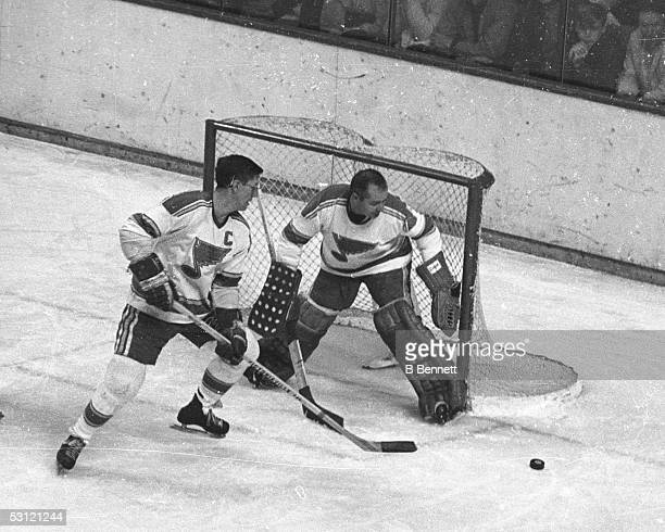 Al Arbour helps out Glenn Hall