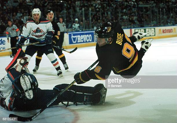 Awesome shot of Vancouver's Pavel Bure scoring on Islander goaltender Jamie McLennan while in midair