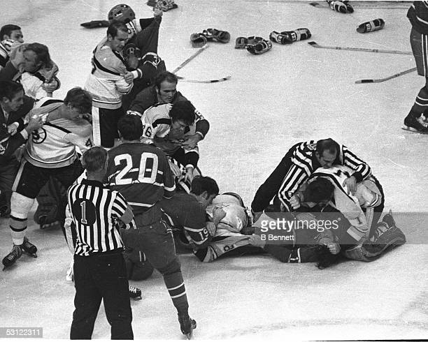 Bruins and canadiens brawl Jean Beliveau holds Bobby Orr