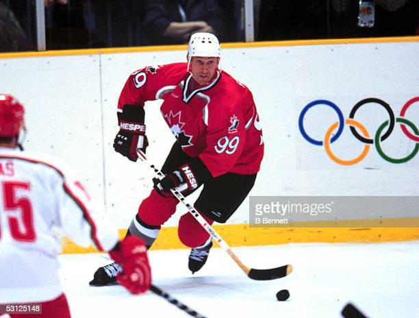 Canada's Wayne Gretzky moves the puck against Belarus