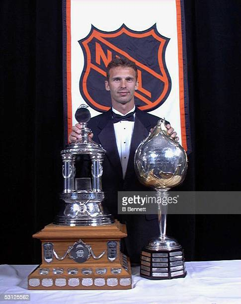 Dominik Hasek of the Buffalo Sabres poses with the Hart Memorial Trophy as MVP to his team and Vezina Trophy as the NHL's oustanding goaltender