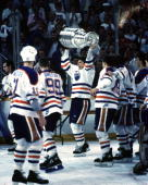 Edmonton Oiler players skate a lap around the ice with the Stanley Cup after defeating the Boston Bruins in the 1988 Finals