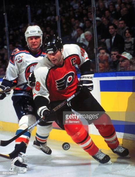 Eric Lindros of the Philadelphia Flyers moves the puck against the New York Islanders as he returns to the ice after recovering from injury