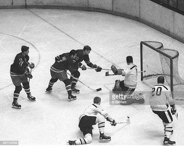 GAG Line Vic Hadfield Rod Gilbert and Jean Ratelle move in on Bobby Orr and Ed Johnston