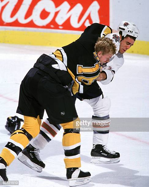 Ken Belanger of the Bruins and Sean Brown of the Oilers go at it