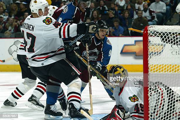 October 10 2003 Linemates again Teemu Selanne and Paul Kariya of the Colorado Avalanche kept pressure on the visting Chicago Blackhawks goalie...