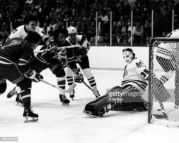 Phil Esposito beats brother Tony Esposito as Rod Gilbert looks on 1976 And Player Phil Esposito