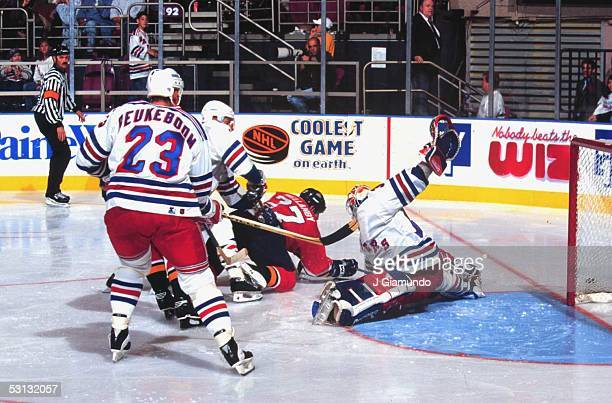 Ranger goaltender Mike Richter does a split to make the save on Florida's Scott Mellanby