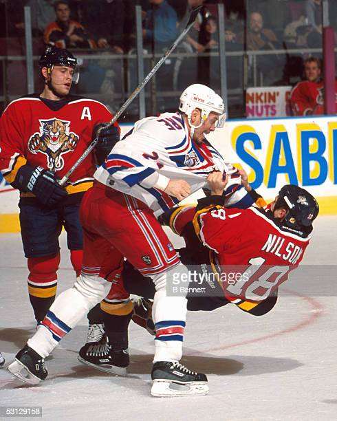 Sylvain Lefebvre of the Rangers drops Marcus Nilson of the Panthers