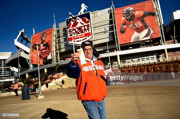 Season ticket holder Mark Bodenstein of Aurora showing his Super Bowl tickets after being one of the first in line at the stadium this morning Those...