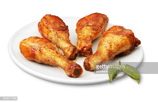 Seasoned chicken legs on a white dish