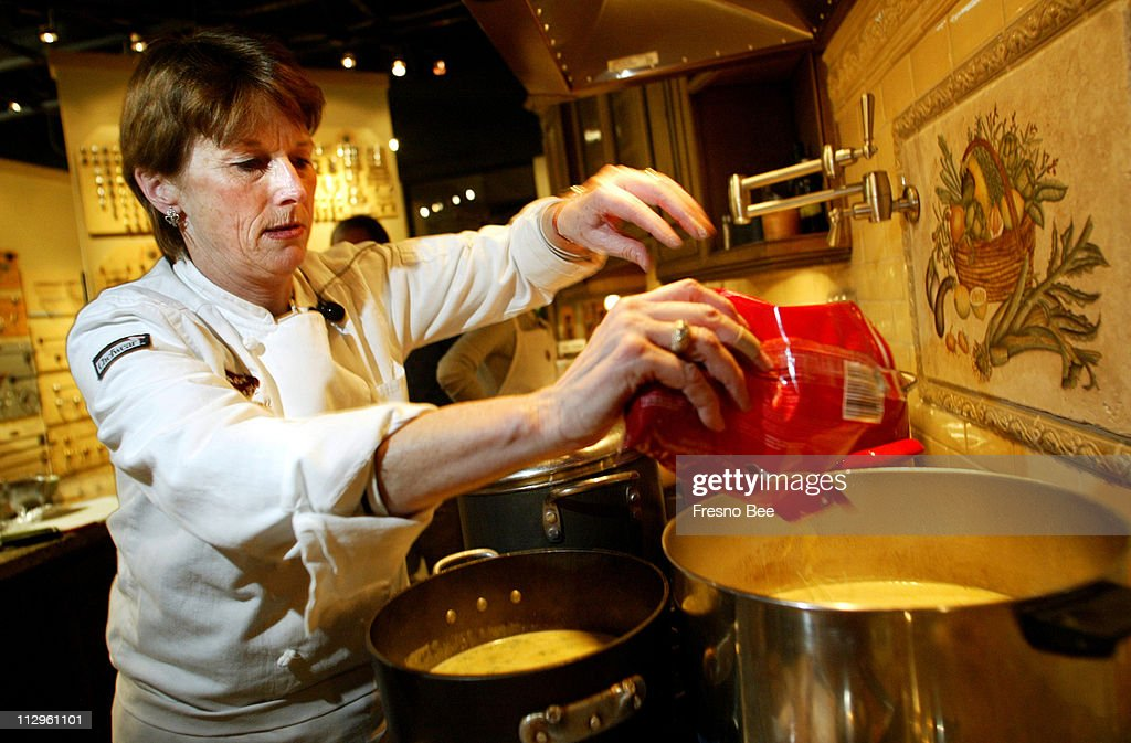 Seasoned To Taste Chef Wendy Carroll Adds Ingredients To A Soup During A  Cooking Class At